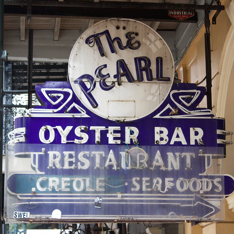 Storefront type and signage for The Pearl Oyster Bar.