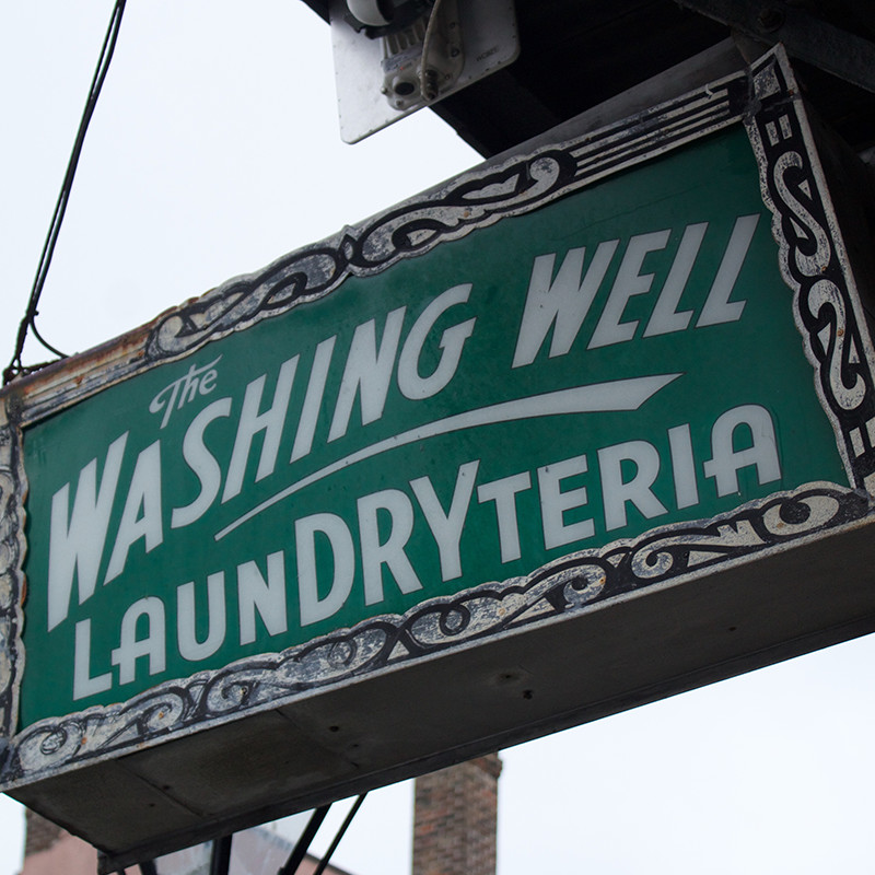 Storefront type and signage for The Washing Well.