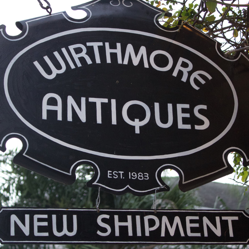 Storefront type and signage for Wirthmore Antiques.