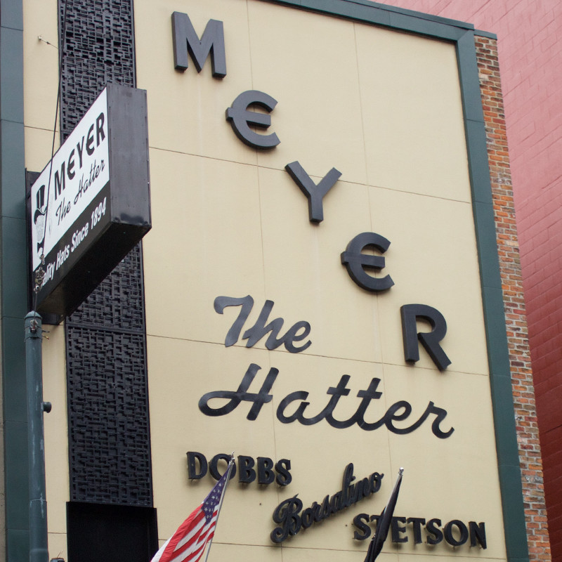 Storefront type and signage for Meyer the Hatter.