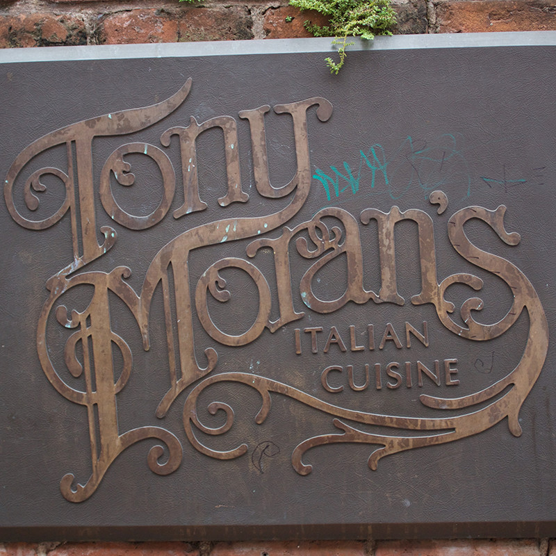 Storefront type and signage for Tony Moran's Italian Cuisine.