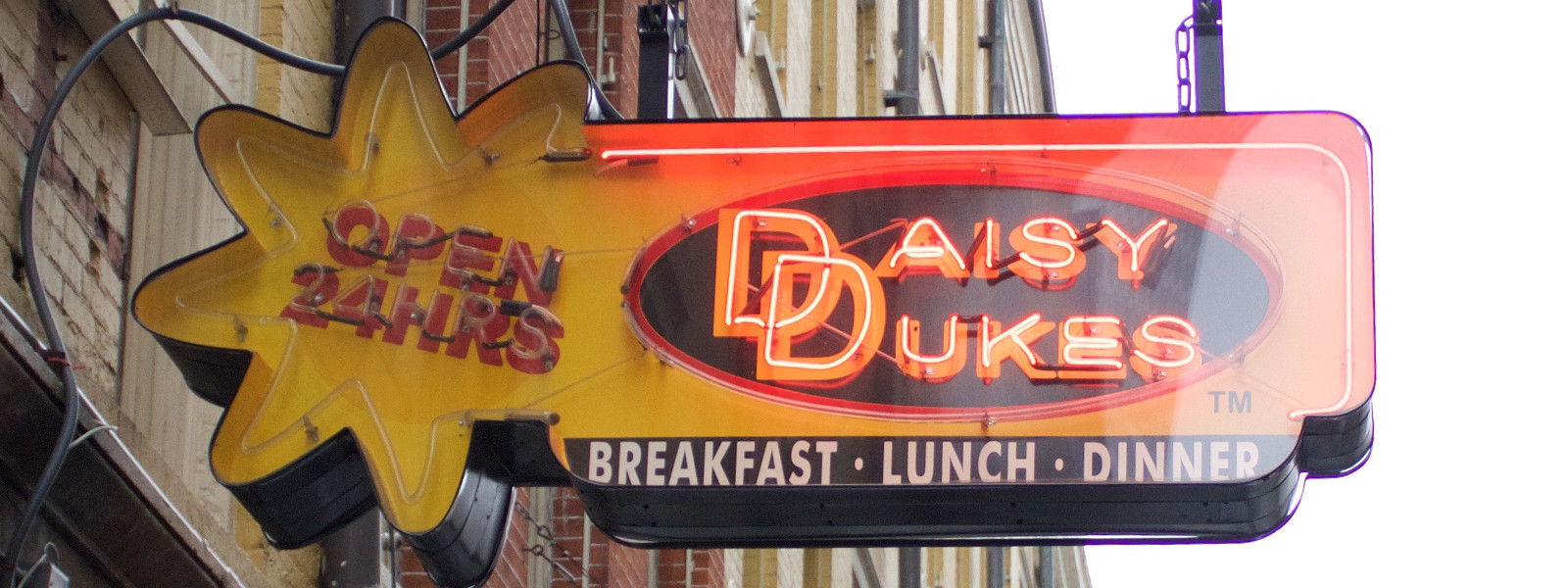 Storefront type and signage for Daisy Dukes.