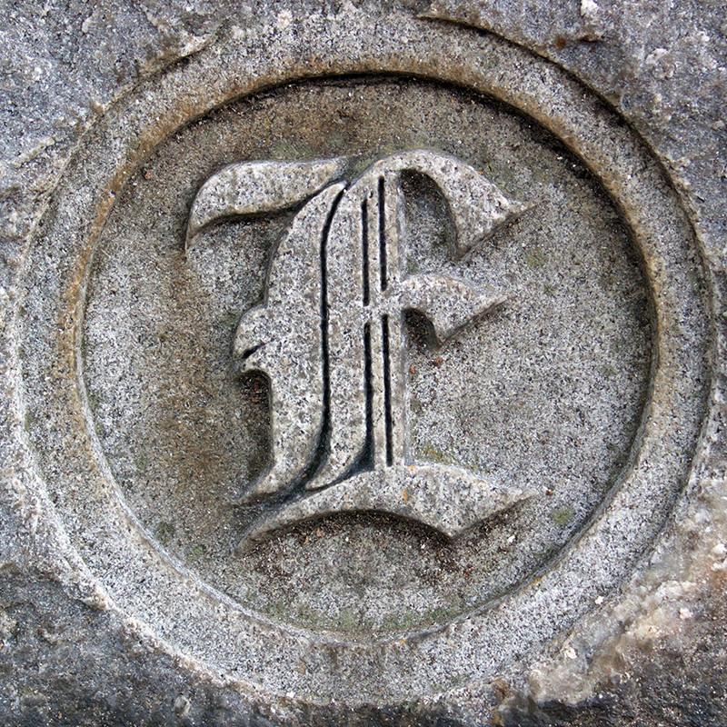 Lafayette cemetery found type. Monogram E